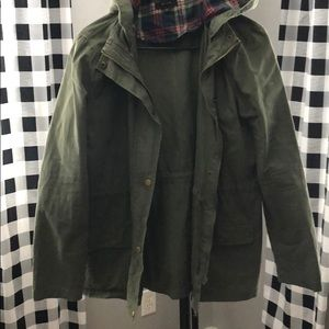 Green jacket with plaid